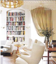 Family room inspiration - Library of a Manhattan townhouse, a custom-made Astor sofa by Jonas Upholstery in a Great Plains fabric, and a Royère chandelier from DeLorenzo Gallery. Arched Window Treatments, Arched Windows, Window Coverings, Home Living Room, Living Spaces, Manhattan, Home Libraries, Elle Decor, Architecture