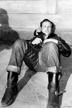 """Marlon Brando in the """"Wild One"""" 1953 #Motorcycle #boots #fashion At Eagle Ages we love Motrocycle boots. You can find a great choice of second hands & vintage Motorcycle boots in our store. https://eagleages.com/shoes/boots/men-boots/motorcycle-boots.html"""