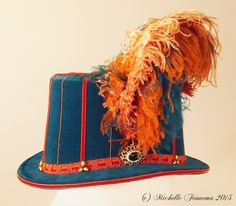 The Lady Stafford--Teal velvet, dark orange velvet and gimp trim, champagne freshwater pearls, vintage brooch, teal, pumpkin, and peach ostrich plumes. By Michelle Fennema, 2015. Teal Pumpkin, Tall Hat, Riding Hats, Historical Women, Jacobean, Costumes For Women, Vintage Brooches, Renaissance, Champagne