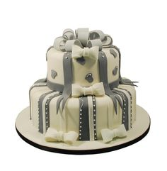 """Iced 8""""&12"""" wedding cake with grey ribbons."""