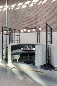 Framework Studio, designed the interior of Meat West, a restaurant located inside De Hallen, a former tram repair depot in Amsterdam. from contemporist Deco Restaurant, Restaurant Interior Design, Commercial Interior Design, Cafe Interior, Commercial Interiors, Luxury Restaurant, Industrial Restaurant, Booth Seating, Banquette Seating