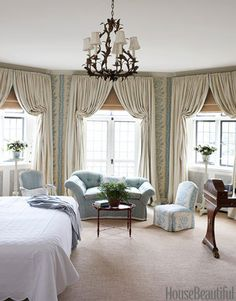 """Designer Markham Roberts wanted pattern in the master bedroom, but he also wanted the room to be peaceful. """"The rest is comfort and softness,"""" he says, """"from the pale beige rug to the ivory curtains.""""   - HouseBeautiful.com"""