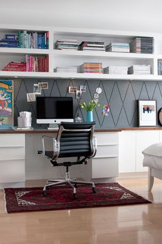 home office with built-in wall shelving, Jess Loraas on Design Sponge via Remodelaholic.com