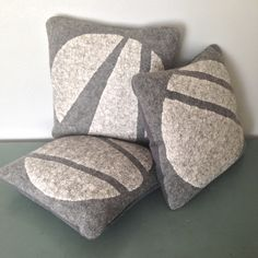 Artfully crafted handfelted pillows, wall hangings and jewelry. Modern lines. Felt Cushion, Felt Pillow, Wet Felting, Needle Felting, Wool Pillows, Throw Pillows, Decorative Pebbles, Felt House, Rock Decor