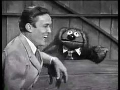 The first Muppet Henson created (with Don Sahlin and Frank Oz) that rose to stardom was Rowlf the Dog, not Kermit. The brown mutt regularly appeared on The Jimmy Dean Show during the mid-1960s.