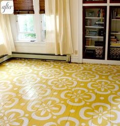 A stenciled hardwood floor (and many more examples at the link). Love the pattern; perhaps for my painted rug?