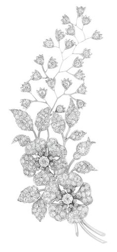 Antique Diamond Corsage Brooch. Rhodium-plated silver, gold, the large curving corsage composed of two flowers amongst climbing leaves and branches, enhanced by 3 old-mine cut diamonds approximately 2.00 cts., set throughout with 197 old-mine cut diamonds approximately 13.00 cts., accented by 32 small rose-cut diamonds.