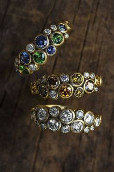 Detail and texture everywhere. 18k gold Alex Sepkus rings with tsavorite, sapphire, diamonds and natural color diamonds. Jewelry is handmade in New York City. Custom color mixes available. #DiamondJewelry