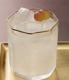 GREY GOOSE® LE CITRON LE MASQUE: Add 1½ parts GREY GOOSE Le Citron Flavored Vodka, ½ parts St. Germain® Elderflower Liqueur, 1 part white grape juice and ½ part pear puree into a cocktail shaker filled with ice. Shake vigorously and strain into a rocks glass filled with ice.