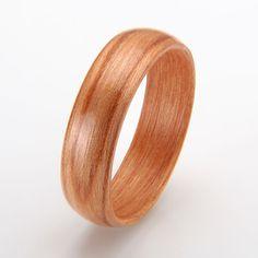 Cherry wood ring. Custom designs.