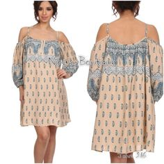 Cold shoulder trapeze dress Paisley print cold shoulder dress has adjustable shoulder straps and is fully lined. Comment with size and I will create a listing. This dress has a generous fit because of the style. Price is firm. Dresses