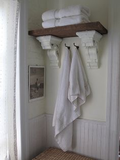 A great idea for using corbels in a bathroom. Find similar, new, shelf supports online at www.buycarvings.com They can easily be painted or stained to m,atch your interior design scheme.