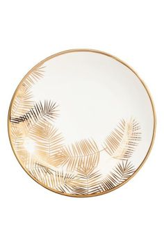 Printed porcelain plate: Small porcelain plate with a gold-coloured print. Diameter15.5 cm.