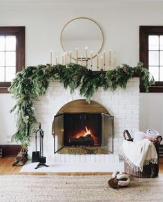Asymmetrical garland: an unexpected take on traditional Holiday fireplace mantel decor. Hear my thought process and how to create the look at your house. christmas fireplace Asymmetrical Garland DIY - Francois et Moi Decoration Christmas, Christmas Mantels, Christmas Home, Christmas Pajamas, Christmas Greenery, Mantle Greenery, Christmas Fireplace Decorations, Mantle Garland, Greenery Garland