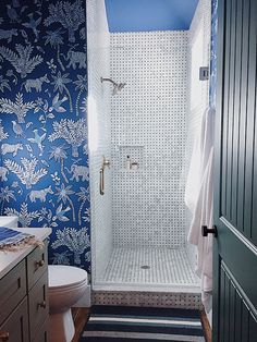 bathroom!! bold wallpaper and beautiful tiles