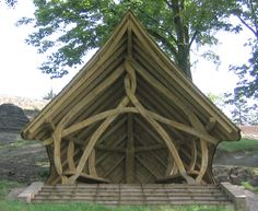 Gerald's Garden | External Oak Shelters | Altham Oak Based on mortice and tenon joints, the external oak shelter is carved from curved timbers that have been worked into a 'living woven frame', which mimics the effect of trees having grown intertwined with each other.