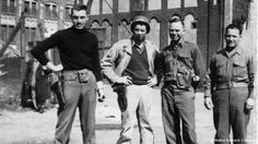 A black and white photo shot in May 1945 with Monuments Men George Stout (left), Walker Hancock (center right), and Steven Kovalyak (right) ...