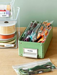 Stash craft supplies in labeled, see-through containers so finding materials is extra easy
