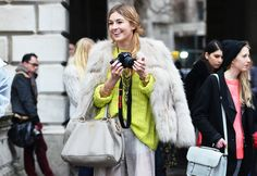Rebecca Minkoff. White palazzo pants, bag and furry coat and yellow sweater