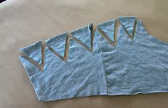 Make this easy T-Shirt with a pair of Scissors. TutorialThings You Need.T-ShirtScissors  Here is a VIDEOCut off the collar.Fold the shirt in half.Mark the shoulder of the shirt with chalk.Cut t