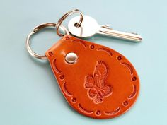 This hand-tooled leather keyring would make an excellent birthday gift for husband. Also, leather goods make great anniversary gifts. Check out my Etsy shop! Leather Bookmark, Leather Keyring, Leather Gifts, Leather Tooling, Leather Craft, Tooled Leather, Handmade Leather, Leather Anniversary Gift, Great Anniversary Gifts
