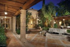 Check out the Mediterranean landscaping elements—from water fountains to wall art to stucco and stone walls—plus a plethora of covered patios and pergolas.