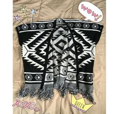 Black and White Fringe Tribal Cover Up Fringe all along the bottom. Received as a gift for Christmas but never worn out. Tore the tags off ): Any questions comment below! Always willing to negotiate/bundle Sweaters Shrugs & Ponchos