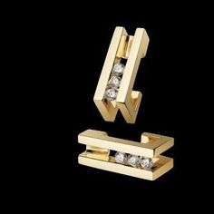 """""""Lines Diamond Earrings"""" - 14-karat yellow gold with six diamonds. Also in white gold."""