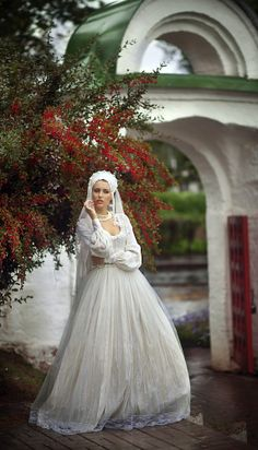 we love this traditional russian bride in a white full length aline dress and full headdress