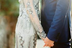 Photography: Peter & Veronika Photography - peterandveronika.com   Read More on SMP: http://www.stylemepretty.com/2015/01/30/whimsical-summer-wedding-with-custom-silver-dress/