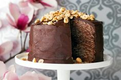 Choc-hazelnut crepe cake This show-stopping cake is a great cheat's sweet made from bought pancakes with chocolate hazelnut spread in between, then covered in rich ganache. (recipe by Lucy Nunes,. Frozen Chocolate, Chocolate Hazelnut, Chocolate Coffee, Chocolate Recipes, Chocolate Cakes, Crepes Nutella, Smitten Kitchen Cookbook, Yummy Treats, Sweet Treats