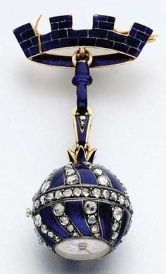 An Antique Blue Enamel and Diamond Lapel-Watch. 18k gold, silver, rose-cut diamonds.