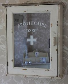 "Vintage style bathroom cabinet- ""Apothecary"" etc sayings on glass. Multi purpose. ""Break glass incase of ___"""