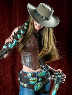 ~ Rock n' Roll Cowgirl! Brit West wearing 3 tiers of her leather belts adorned in turquoise around her waist. A fab way to wear them while displaying her leather & turquoise cuffs on her shoulder. ~