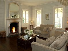 Lounge with dark wooden floors and cream furnishings