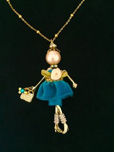 Cancer support jewelry -- french doll pendant necklace with awareness ribbon by Ellie's Belles.