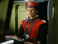 Captain Scarlet is shown sitting in the driver's seat of one of thousands of Spectrum Pursuit Vehicles, or SPVs. He was only moderately skilled at driving them, and would often crash them.