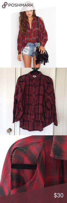 "UNIF Flannel Cutout Shirt Oversized crinkled flannel shirt featuring cut out shoulders and a red, ivory and black plaid print. Button-down front, cut longer at back. Looks awesome paired with leather shorts and platform boots! By UNIF. *100% Cotton. *21.5"" length at front, 30"" length at back. UNIF Tops Button Down Shirts"