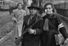 Young couple in Budapest, during the Hungarian Revolution of 1956 [[MORE]] The man with the riffle was 17 years old and got killed by the soviet police 2 hours after this photo was taken. The woman escaped and died in 1990 in Australia. The man with. World Conflicts, Michael Crichton, Dangerous Woman, My Heritage, Vintage Photographs, Vintage Images, Life Magazine, The Real World, Eastern Europe
