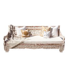 "This sturdy carved whitewashed daybed is hand carved with scrolling floral design and made from reclaimed teak wood with ample room to lounge. Foam mattress, 4"" with the a white cotton cover is included. Slats and sides come apart for easy shipment. Seat height is 16"""
