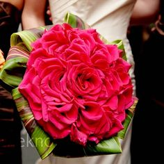 What an amazing bouquet!! Bright fuschia duchess rose bouquet - hundreds of individual rose petals designed to look like one giant rose.