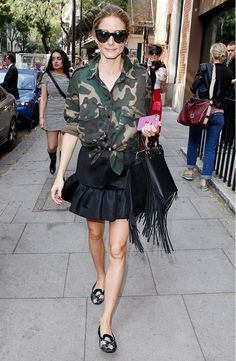 Olivia Palermo wears a camo top and a black skirt in the most stylish way possible. // #StreetStyle