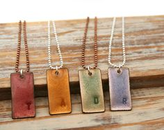 Sweet little personalized stamped initial enamel pendant necklace on basemetal chain.