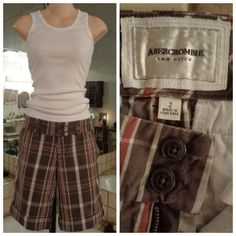 """Chocolate Brown/Red 32X11 Plaid Wide Cuff Bermuda Made by: Abercrombie and Fitch Size 2 Brown/Red/Tan Dressy style w/Wide Belt Loops, Hip pockets, Open Back Pockets. Measurements: Laid Flat across Waist 16"""" Rise 7.5"""" Double Button Closure w/ 3""""Zipper Inseam 11"""" with wide cuff Laid Flat across the Hem 9.75"""". Material: 100% Cotton  Shorts in Excellent condition Minimal Fade from wash. Thank you for browsing my closet. Abercrombie & Fitch Shorts Bermudas"""