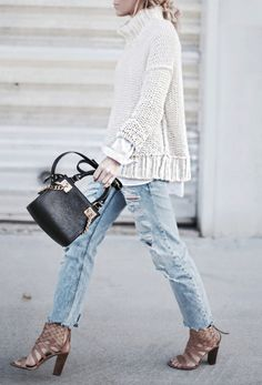 Chic sweater, boyfriend jeans, cage heels, and a fabulous bag. This is the perfect fall uniform.