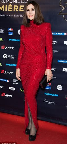 Vision in red: Monica Bellucci showed off her incredible physique at the 23rd Lumieres Aw...
