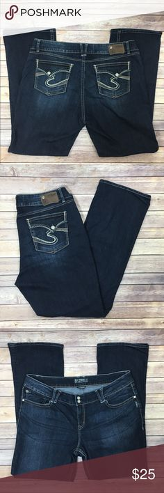 """Silver Jeans Co Dawson 22W x 34 Crystal Accents Silver Jeans Co Dawson 22W x 34 Crystal Accents in EUC.  Jeans are a dark wash, and have crystal accents on the buttons.  Fabric is 78% cotton, 21% polyester and 1% spandex.  Measurements are approximately 20.5"""" waist, 34"""" inseam and 11"""" rise.  They come from a smoke free home. Silver Jeans Jeans"""