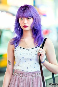 72658931faf Purple haired Harajuku girl wearing a