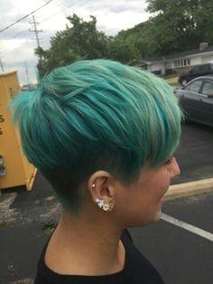Pravana turquoise colored pixie cut