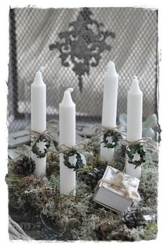 Idea can be used for Advent Wreath. Using white candles, place a circlet of color around each: 3-purple and 1-pink.